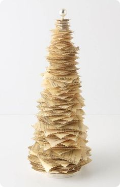 anthropologie paper christmas tree (inspiration for DIY - knock off decor) another use for those old books