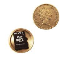 $24.99 | Micro SD Card Covert Spy Coin – Secret Compartment (British Pound) | FuturisticSHOP.com