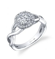 This dazzling diamond engagement ring features a 1 carat round brilliant center diamond. Beautifully designed to accentuate the center diamond, this diamond engagement ring has a total of 0.12 carats of round brilliant diamonds surrounding the head. The diamond engagement ring is available in any size or shape center stone, in 18K white gold or platinum. All Sylvie Collection diamond engagement rings are available with a flush fit matching wedding band. (For pricing on this diamond…
