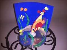 Use an old CD and colorful foam aquatic cut outs (or punch outs) to create a cool underwater scene. A small river stone is used to secure the tropical fish with a bit of hot glue. Made several of these as a birthday activity when my kids were young. Perhaps I had the most fun!