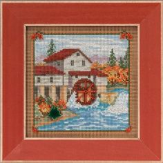 Country Mill (Country Lane Series) - by Mill Hill. I finished this with petite citron beads & yellow green cross stitch border in between bright orange cross stitch border. It gives a little sparkle & contrast.