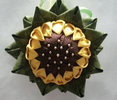 Sunflower quilted ornament with gold beads. Back is all green matching the leaves. Fabric may vary but colors are consistent. Quilted Fabric Ornaments, Quilted Christmas Ornaments, Handmade Christmas, Ornaments Image, Beaded Ornaments, Ball Ornaments, Scandinavian Christmas Ornaments, Sunflower Quilts, Fabric Origami