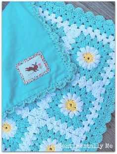 Daisy Crochet Blanket with Fabric Backing - free pattern on our site