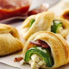 This unusual twist on chile poppers, with herbed cheese and a dollop of sweet salsa, roll up fast when prepared with Pillsbury® crescent dough.