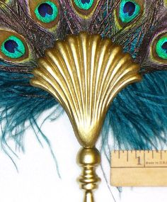 Turquoise and Peacock Feathers  with Golden Wand .