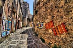 Typical #colorful carpets of #Erice. Walking in #Erice. Don't choose the main streets but get lost in the secondary alleys, look the towers from another point of view and enjoy this strange medieval town, which let its light shine in #spring and #fall. It's just 10 minutes from #Trapani. To know more have a look at #B&B Belveliero bebtrapanilveliero.it