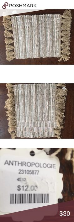"Anthropologie Set/4 woven placemats Set of 4 woven placemats. Natural colors with silver woven in. Fringed on either end. 13x17"". 