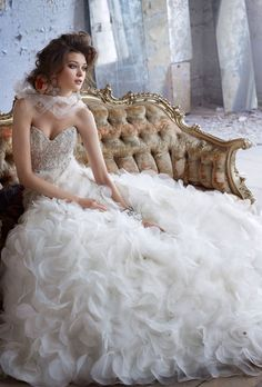 Brides: Lazaro. Floral organza ball gown, strapless sweetheart neckline, sheer corseted jewel encrusted bodice, floral organza A-line skirt with crystal accent, chapel train.