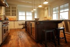 Mixed finishes, fabulously rustic floors, love. #kitchen #flooring #cabinets