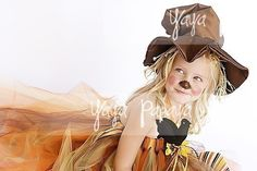 Little girl scarecrow...I could probably talk Audrey into any costume idea as long as I made it with a big tulle skirt.