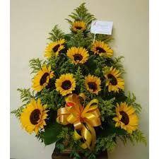 Resultado de imagen para arreglos florales con girasoles y rosas