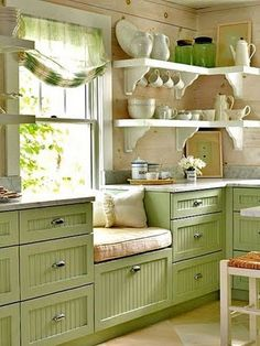 Cozy green kitchen-not a bad idea for the bathroom