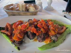 Aspendos, a Turkish restaurant in downtown Stuttgart, Germany, specializes in grilled meats and fish. Here, grilled lamb is served on yogurt and topped with a red-pepper sauce. (JOHN VANDIVER/STARS AND STRIPES)