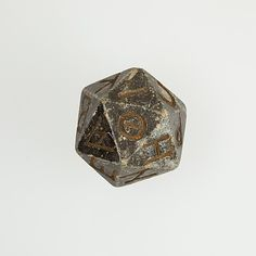 nerrrrrrrrrrrrrdz [2000 year old egyptian 20 sided die with greek characters, 2nd century B.C.–4th century A.D.]