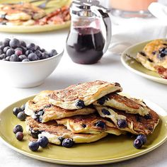 Blueberry-Ricotta Pancakes -  Creamy ricotta and a handful of juicy blueberries transform your boring batter into an out-of-this-world pancake feast. Don't forget to drizzle on our homemade maple-berry syrup for even more fruity flavor. Blueberry-Ricotta Pancakes Yield: 16 pancakes Prep: 20 mins Cook: 2 mins
