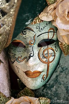 A luxurious venetian mask with gold details. Beautiful and mysterious. Would look amazing in masquerade