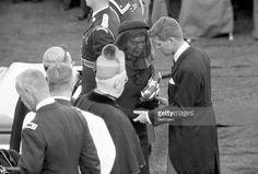 News Photo : A devastated Jackie Kennedy holds the folded...