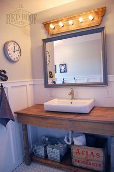 Wooden vanity light boys farmhouse bathroom remodel barn wood vanity grey bathroom board and batten re Farmhouse Bathroom Sink Faucets, Downstairs Bathroom, Laundry In Bathroom, Barnwood Bathroom Vanity, Small Bathroom, Barn Bathroom, Wooden Vanity, Bathroom Bin, Bathroom Countertops
