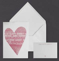 Our Thatched Heart invitation suite is shown here letterpress printed in peony ink.
