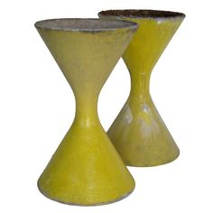 Pair of Willy Guhl Concrete Planters  Switzerland  1950's  A pair of Willy Guhl concrete planters for Eternit. Shaped like hourglass. Vintage yellow paint-not original.