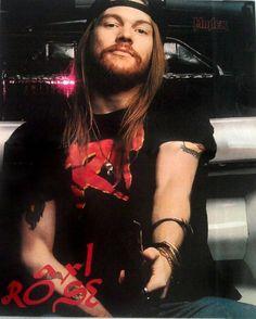 Axl Rose holding a Mossberg shotgun Axl Rose, Guns N Roses, Dave Matthews Band, Hard Rock, Metallica, Gilby Clarke, Appetite For Destruction, Sweet Child O' Mine, Steve Perry