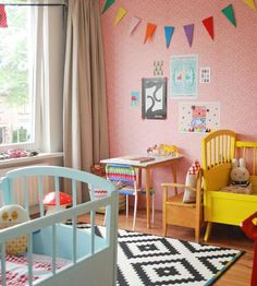 Rainbow Nursery Room, black & white rug, colorful decor, pink walls, neutral curtains