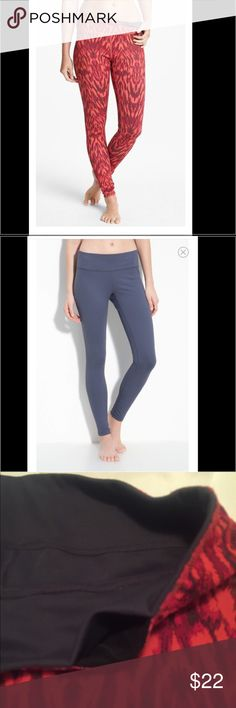 Zella live in leggings reversible charcoal and red Zella reversible leggings.  Flattering fit and versatile.  I thought there was a tiny snag from when I held a puppy and it's claw caught it but I can't find it. Priced accordingly though. Zella Pants Leggings