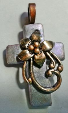 simple clay cross pendant with metal embellishment.