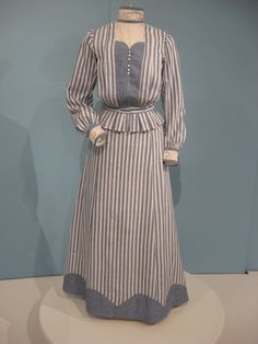 Heavy cotton blue and white striped dress with lace inserts (American), circa 1905.