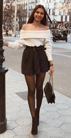 how to style a mini black skirt : bag + off shoulder sweater + boots