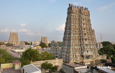 The Meenakshi temple has majestic stonewalls and towers rising out of the swarming streets of the city center.