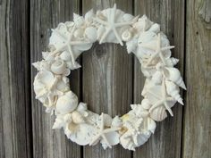 SEASHELL WREATH with white and ivory shells and starfish. $130.00, via Etsy.