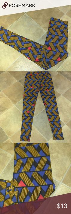 """LuLaRoe Leggings - One Size Great Condition item in beautiful vibrant geometric zig zags and lines of  black, blue, red and mustard gold/yellow. Waists Unstretched 12.5"""". Inseam Unstretched 27"""". Loc:b2 LuLaRoe Pants"""
