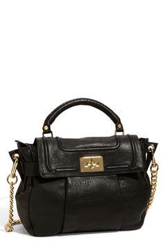 I usually don't like black purses but this one is fab