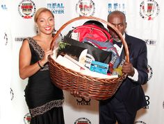 Roger Mayweather hiding behind his Inductee basket at the Nevada Boxing Hall of Fame 2015 Gifting Gala