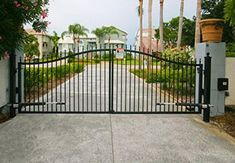 W x 5 ft. H 2 in. Powder Coated Steel Dual Driveway Fence - The Home Depot Aluminum Driveway Gates, Driveway Fence, Fence Gate, Fencing, Spanish Revival Home, Spanish Style Homes, Spanish House, Automatic Gate Opener, Gate Openers