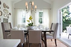 As seen on HGTV's Love It or List It Too, Jillian Harris designed a dining room for the family that is elegant and contemporary, with a vintage touch. The table and chairs add a contemporary feel to the space with their stark lines and unique designs, while the vintage silver serving trays give the space a classic feel. The large French doors can be opened to let in sunlight or to bring the outside in.