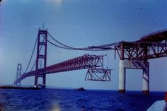 The Mackinac Bridge under construction ca. 1956 — Gift Baskets From Michigan Michigan Water, Michigan Travel, State Of Michigan, Detroit Michigan, Northern Michigan, Lake Michigan, Old Bridges, Mackinaw City, Bridge Construction