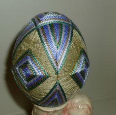 Temari Egg created using Purple and Sage Green over Tan Base