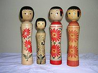 """Oshin (Naruko) Dolls Oshin dolls are designed after the Naruko doll with their distinctive shoulders. These pretty ladies were made after a very popular serialized telvision program featuring """"Oshin,"""" a poor woman who overcomes hardships to make a better life."""
