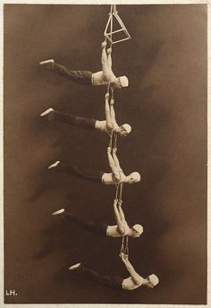 Suspended by suspenders, Vintage Circus Performers.
