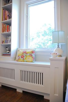 We're loving the way turned an awkward corner radiator into a room focal-point with the addition of a custom slatted window bench and bookcase. Canapé Design, Interior Design, Cover Design, Window Benches, Window Seats, Designer Radiator, Built In Seating, Built In Bookcase, Bookcase Bench