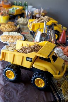 """This Idea Came From A Birthday Party...But I Think It Would Be Super Cute As A """"Boy Theme"""" Baby Shower...Use Plastic Dump Trucks As Bowls To Hold Snack Foods"""