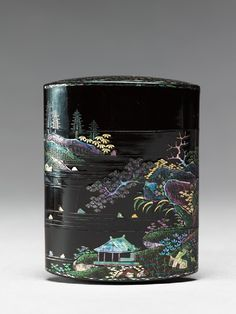 Inrō with landscape. Material:wood, covered in black lacquer, with carved decoration, and inlaid aogai