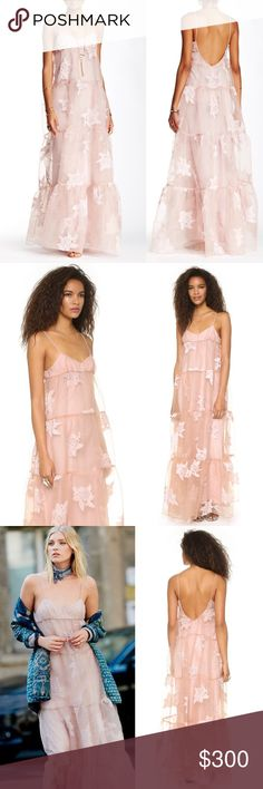 Free People Rose Pink Tulle Gown Free People Rose Tiered Maxi Dress  $400.00, sold out!  An elegant and airy Free People maxi dress accented with a sheer tiered floral overlay and spaghetti straps. Lined. This was worn briefly for a photo with no flaws or signs of wear. It is in excellent condition and like new. Perfect prom dress.  Fabric: Crepe. Shell: 71% rayon/22% polyester/7% linen. Dry clean.  Measurements Length: 60.5in / 153.5cm, from shoulder Size 6, fits like a Medium and has an…