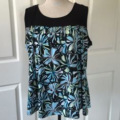 Blue Floral Top Color is vibrant and cool to the eyes! Just perfect for this summer! Fave' Tops