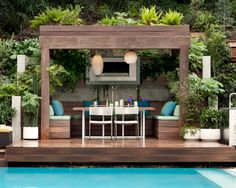 The symmetry of this poolside cabana designed by Jamie Durie creates good feng shui balance. Jamie Durie, Outdoor Rooms, Outdoor Dining, Dining Area, Outdoor Daybed, Dining Room, Dining Table, Pool Gazebo, Backyard Pools