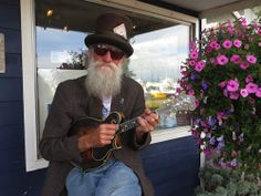 Peter on ukelele, baskets by The Basket Case greenhouse