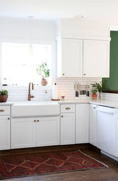 Learn how one blogger, Sarah Gibson of Room For Tuesday, flipped a foreclosure kitchen with the help of her husband, family, and friends. Read tips and valuable advice for diy kitchen remodel cost and ideas.