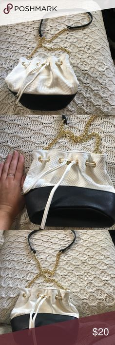 bucket bag, like new bought from nasty gal but brand is like dreams. only used once, its like new. white and black with gold hardware. one inside pocket that zips. top of back tightens and loosens and has a magnetic snap closure Nasty Gal Bags Crossbody Bags
